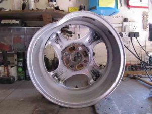curb hit four spoke alloy wheel