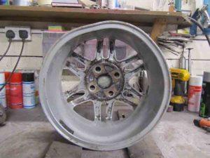 Buckled alloy wheel