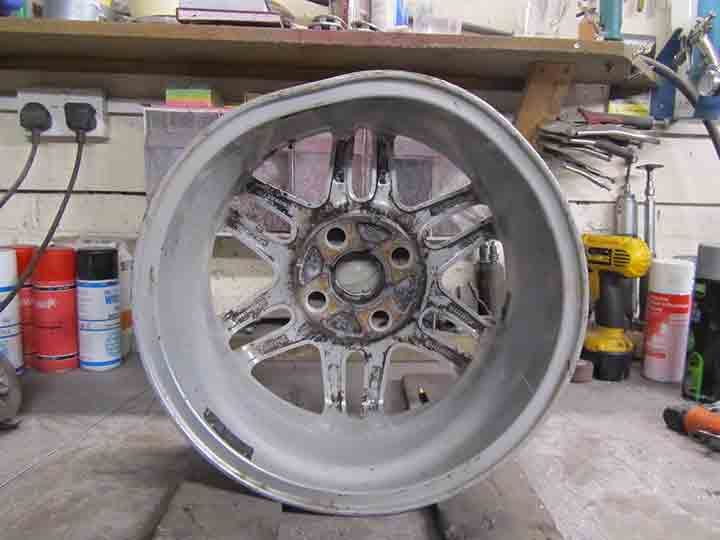 Buckled alloy wheel