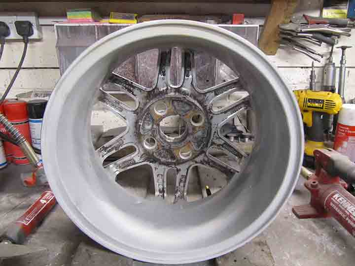 Alloy wheel straitened and primed.