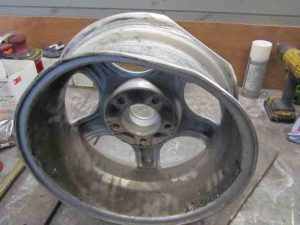 dented alloy wheel ready for stage one of repair