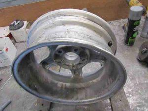alloy wheel being inspected before repair