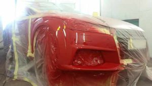 Red audi is spray booth